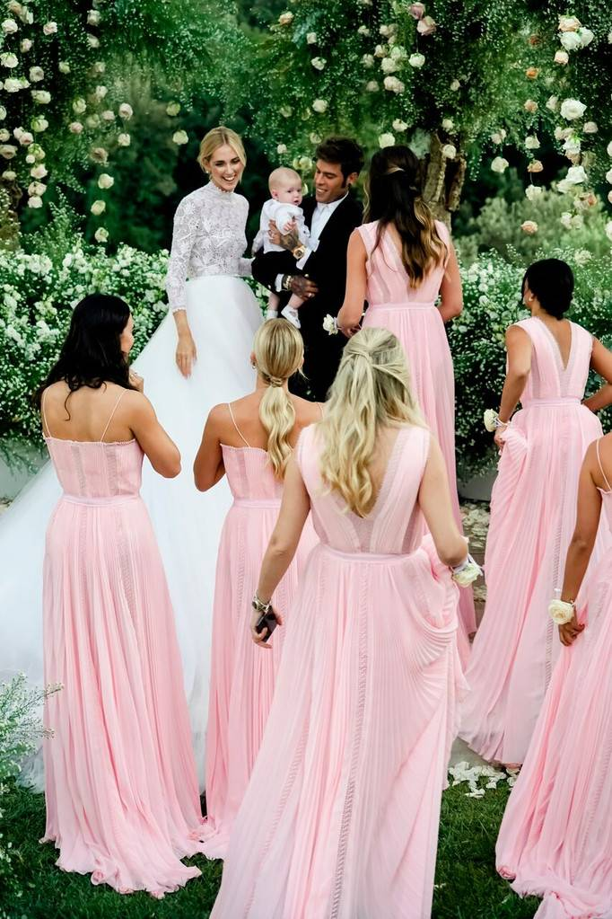 Chiara Ferragni, the influencer, surrounded by bridesmaids in Alberta Ferretti pink gowns.